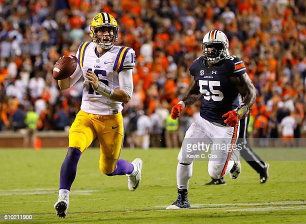 Danny Etling of the LSU Tigers looks to pass for a touchdown to end the game against Carl Lawson of the Auburn Tigers at JordanHare Stadium on...