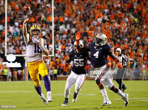 Danny Etling of the LSU Tigers passes for a touchdown to end the game against Jeff Holland and Carl Lawson of the Auburn Tigers at JordanHare Stadium...