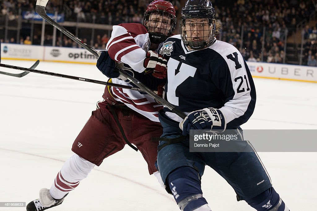 Danny Fick #7 of the Harvard Crimson skates against <a gi-track='captionPersonalityLinkClicked' href=/galleries/search?phrase=John+Hayden+-+Ice+Hockey+Player&family=editorial&specificpeople=15212509 ng-click='$event.stopPropagation()'>John Hayden</a> #21 of the Yale Bulldogs on January 11, 2014 at Madison Square Garden in New York, New York.
