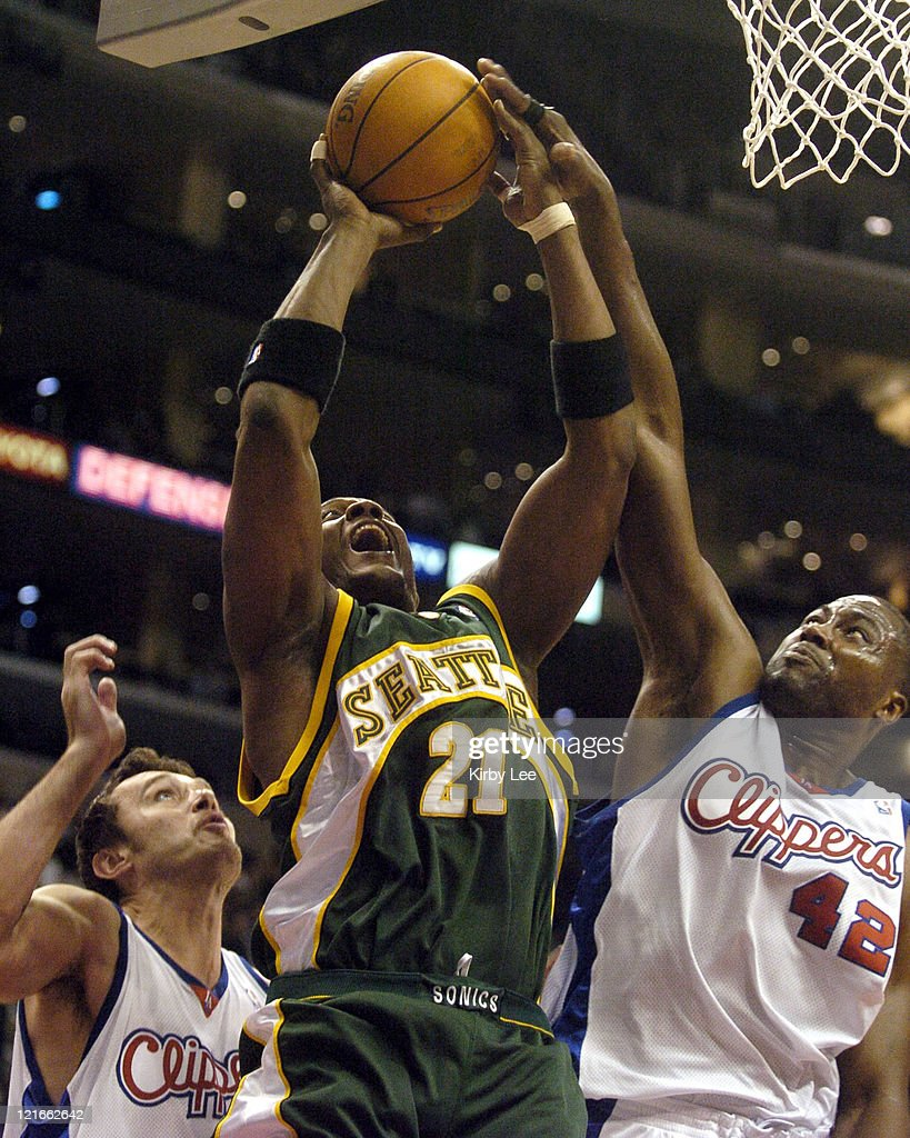 Danny Fortson of the Seattle SuperSonics is defended by <a gi-track='captionPersonalityLinkClicked' href=/galleries/search?phrase=Elton+Brand&family=editorial&specificpeople=201501 ng-click='$event.stopPropagation()'>Elton Brand</a> (42) and Zeljko Rebraca of the Los Angeles Clippers during the game between the Seattle SuperSonics and the Los Angeles Clippers at the Staples Center in Los Angeles, California, on January 12, 2005. The Clippers defeated the SuperSonics 103-92.