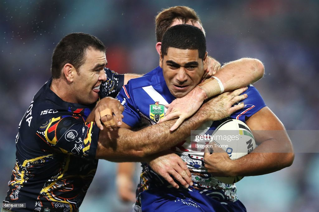 Danny Fualalo of the Bulldogs is tackled by the Cowboys defence during the round 10 NRL match between the Canterbury Bulldogs and the North Queensland Cowboys at ANZ Stadium on May 11, 2017 in Sydney, Australia.