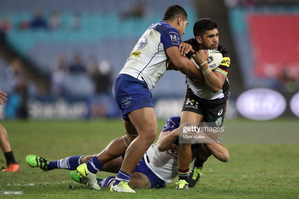 Danny Fualalo of the Bulldogs tackles Tyrone Peachey of the Panthers during the round 13 NRL match between the Canterbury Bulldogs and the Penrith Panthers at ANZ Stadium on June 4, 2017 in Sydney, Australia.