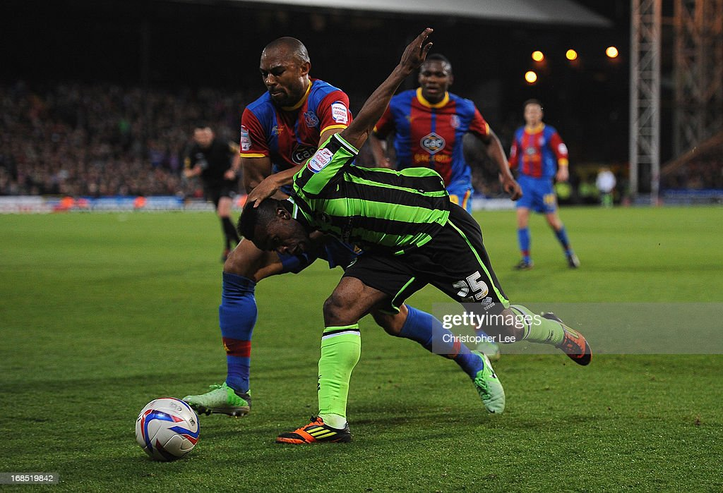 Danny Gabbidon of Palace battles with Kazenga LuaLua of Brighton during the npower Championship Play Off Semi Final, First Leg at Selhurst Park on May 10, 2013 in London, England.