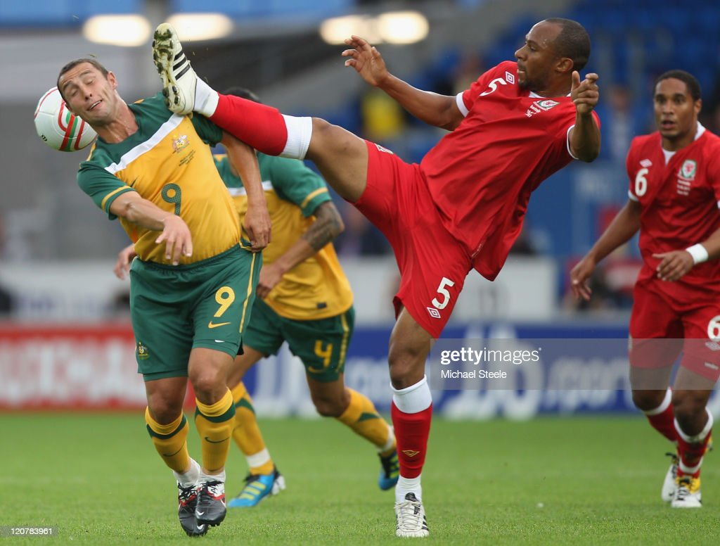 Danny Gabbidon of Wales challenges Scott McDonald of Australia during the International Friendly match between Wales and Australia at the Cardiff...