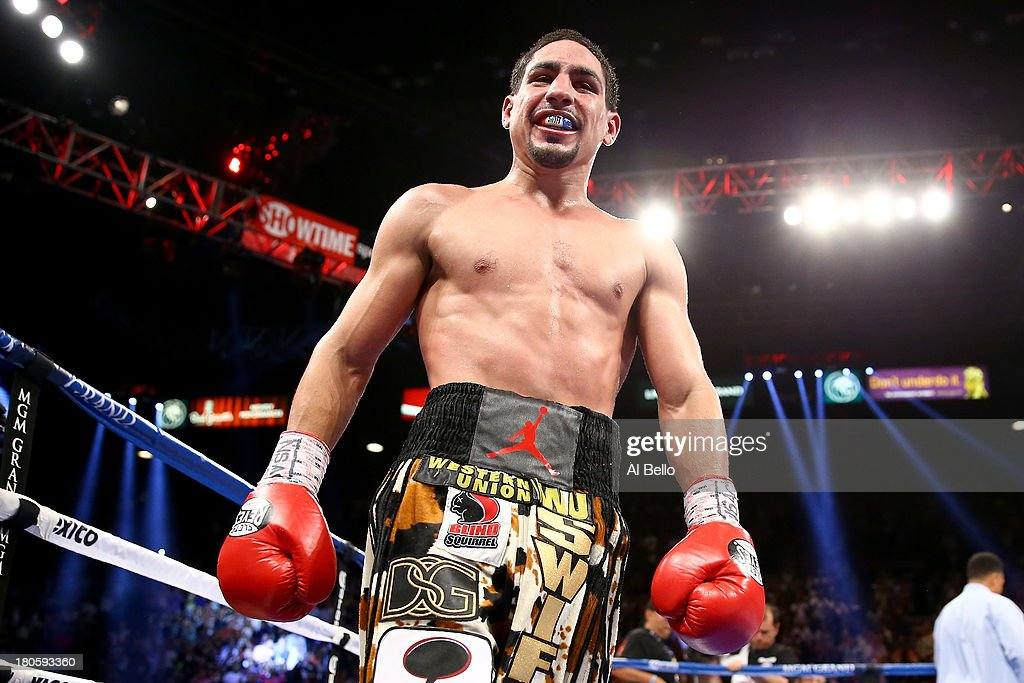 Danny Garcia celebrates after the 12th round against Lucas Matthysse in their WBC/WBA super lightweight title fight at the MGM Grand Garden Arena on September 14, 2013 in Las Vegas, Nevada.