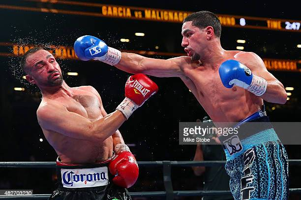 Danny Garcia lands a punch against Paulie Malignaggi during their welterweight bout at Barclays Center on August 1 2015 in Brooklyn borough of New...