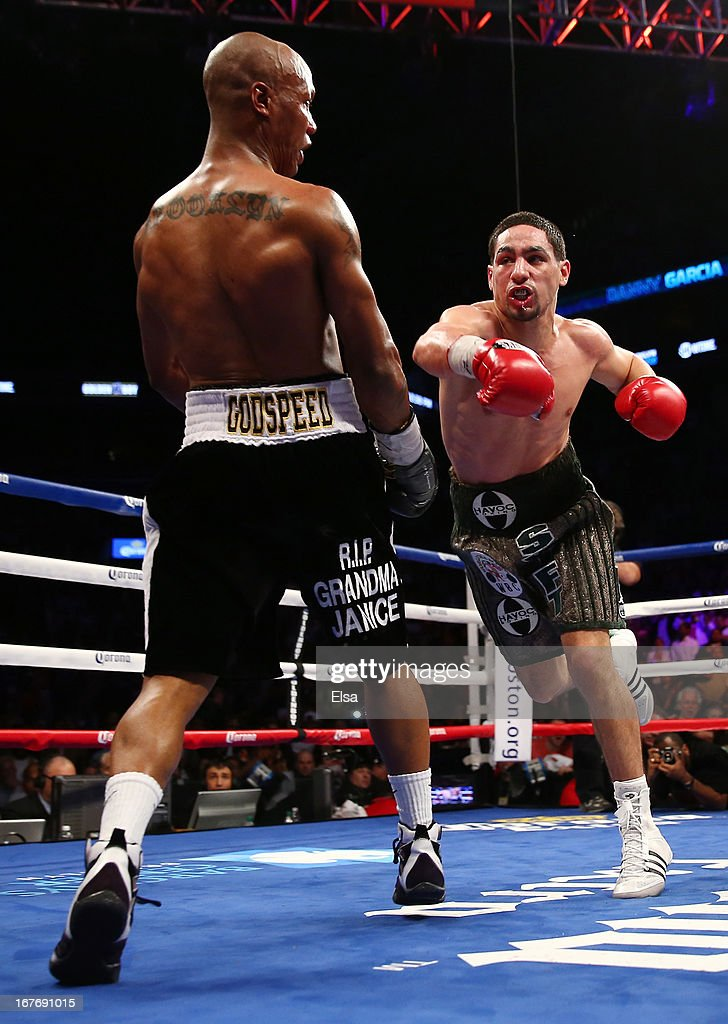 Danny Garcia takes a swing at <a gi-track='captionPersonalityLinkClicked' href=/galleries/search?phrase=Zab+Judah&family=editorial&specificpeople=172008 ng-click='$event.stopPropagation()'>Zab Judah</a> during the WBA Super and WBC Super Lightweight title fight at Barclays Center on April 27, 2013 in the Brooklyn borough of New York City.Garcia was declared the winner after 12 rounds.