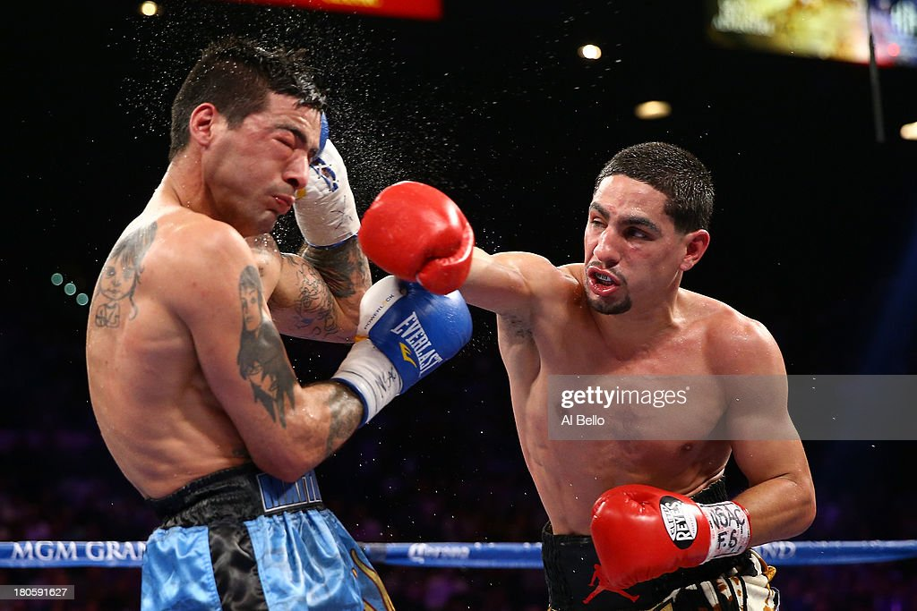 Danny Garcia throws a right to the head of Lucas Matthysse during their WBC/WBA super lightweight title fight at the MGM Grand Garden Arena on September 14, 2013 in Las Vegas, Nevada.