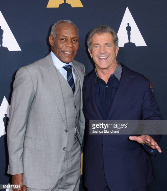 Danny Glover and Mel Gibson arrive at The Academy Celebrates Filmmaker Richard Donner at Samuel Goldwyn Theater on June 7 2017 in Beverly Hills...