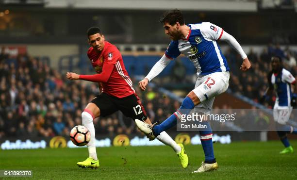 Danny Graham of Blackburn Rovers shoots past Chris Smalling of Manchester United as he scores their first goal during The Emirates FA Cup Fifth Round...