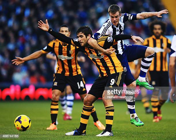 Danny Graham of Hull City and Alex Bruce of Hull City challenge for the ball during the Barclays Premier League match between West Bromwich Albion...
