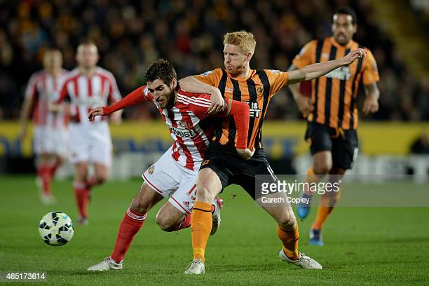 Danny Graham of Sunderland and Paul McShane of Hull City compete for the ball during the Barclays Premier League match between Hull City and...