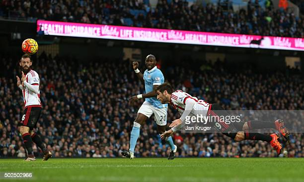 Danny Graham of Sunderland directs a header on goal during the Barclays Premier League match between Manchester City and Sunderland at the Etihad...