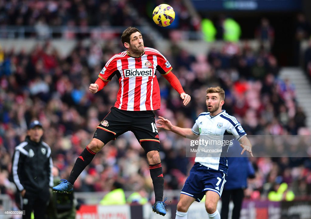 Danny Graham of Sunderland heads the ball under pressure from James Morrison of West Brom during the Barclays Premier League match between Sunderland and West Bromwich Albion at Stadium of Light on February 21, 2015 in Sunderland, England.