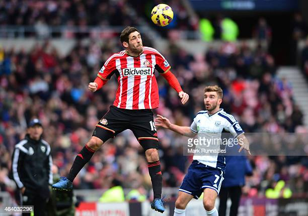 Danny Graham of Sunderland heads the ball under pressure from James Morrison of West Brom during the Barclays Premier League match between Sunderland...