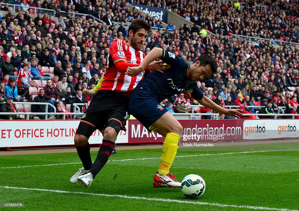 Danny Graham of Sunderland is held off by Maya Yoshida of Southampton during the Barclays Premier League match between Sunderland and Southampton at...