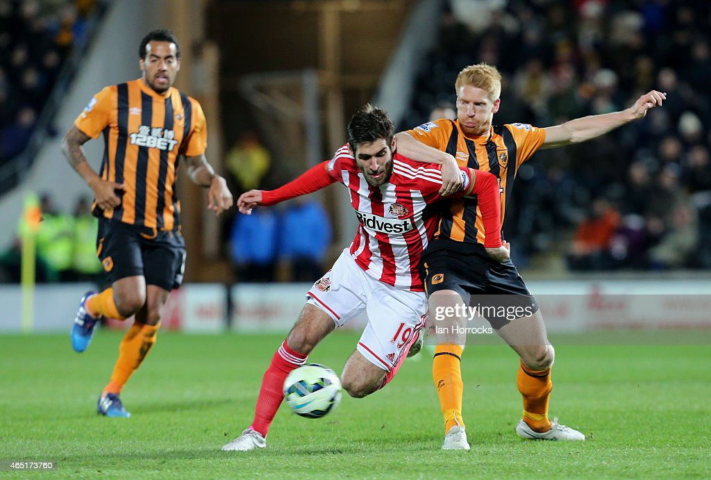 Danny Graham of Sunderland is tackled by Paul McShane of Hull City during the Barclays Premier League match between Hull City and Sunderland AFC at...