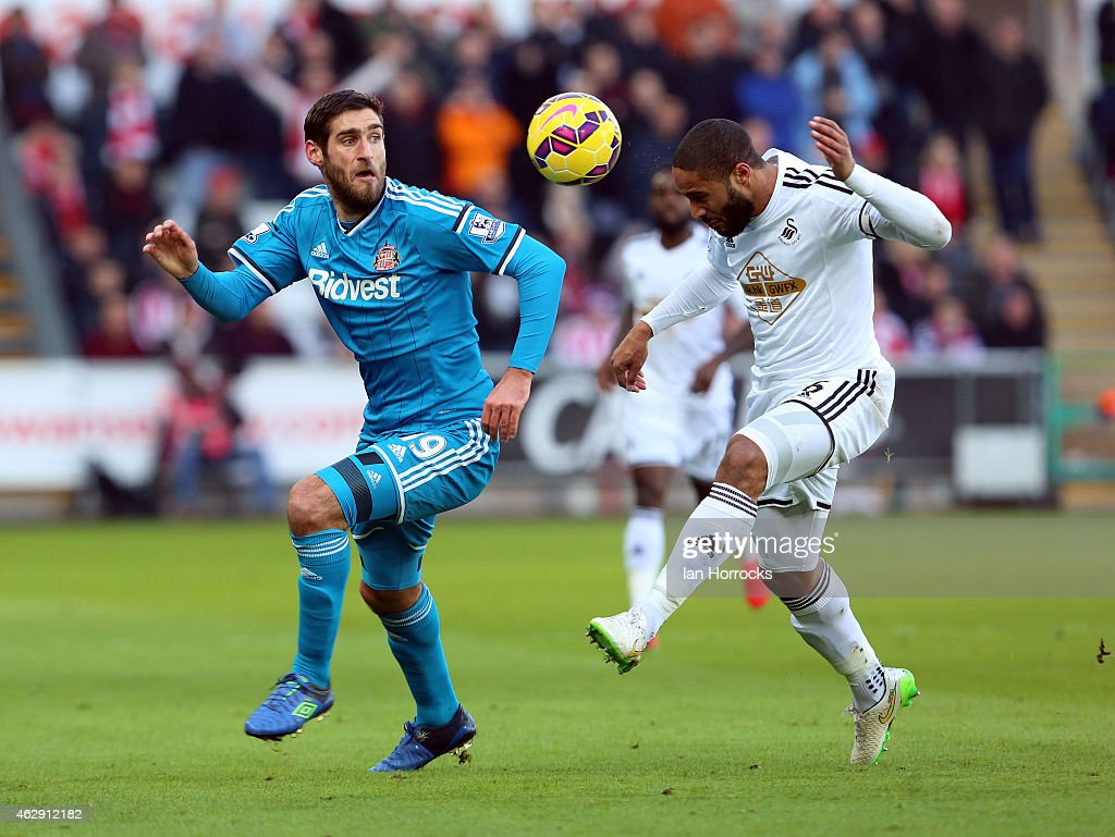 Danny Graham of Sunderland (L) takes on Ashley Williams of Swansea City during the Barclays Premier League match between Swansea City and Sunderland at the Liberty Stadium on February 07, 2015 in Swansea, Wales.