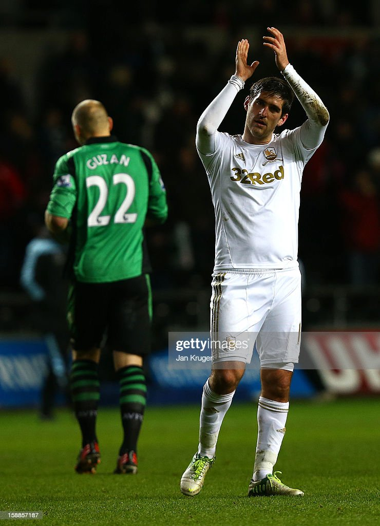Danny Graham of Swansea City applauds the fans at the final whistle during the Barclays Premier League match between Swansea City and Aston Villa at the Liberty Stadium on January 1, 2013 in Swansea, Wales.