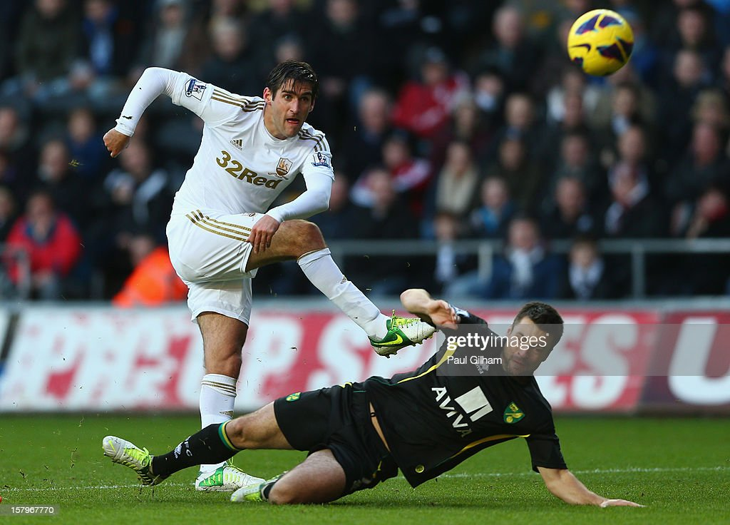 Danny Graham of Swansea City battles for the ball with <a gi-track='captionPersonalityLinkClicked' href=/galleries/search?phrase=Russell+Martin+-+Soccer+Player&family=editorial&specificpeople=13764026 ng-click='$event.stopPropagation()'>Russell Martin</a> of Norwich City during the Barclays Premier League match between Swansea City and Norwich City at the Liberty Stadium on December 8, 2012 in Swansea, Wales.