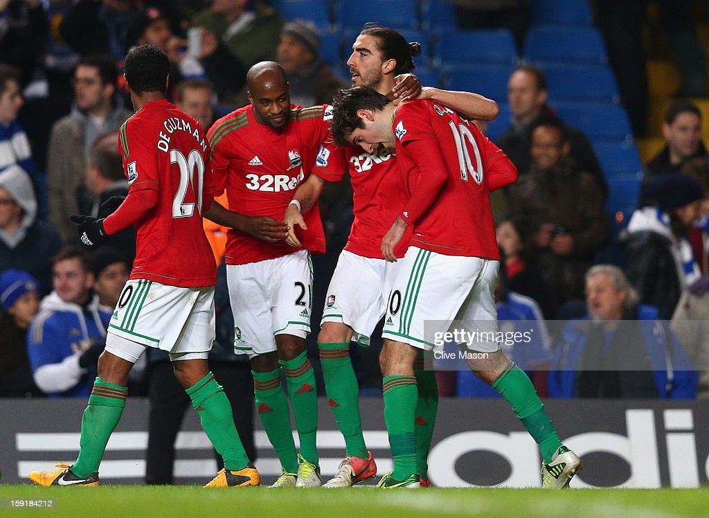 Danny Graham of Swansea City celebrates his goal with team mates during the Capital One Cup Semi-Final first leg match between Chelsea and Swansea City at Stamford Bridge on January 9, 2013 in London, England.
