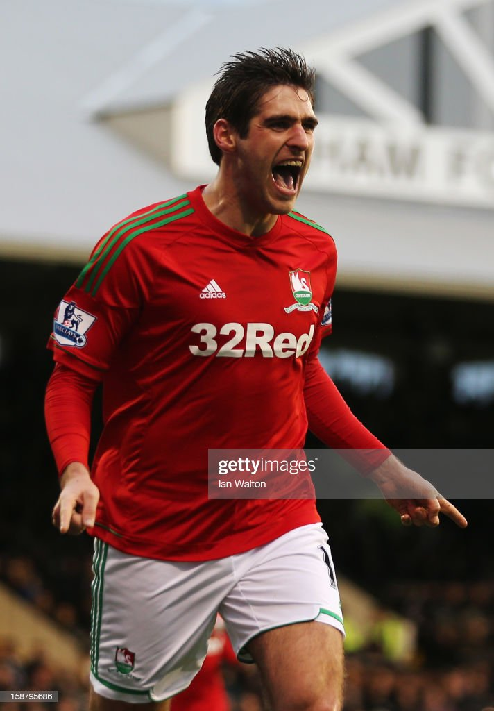 Danny Graham of Swansea City celebrates scoring during the Barclays Premier League match between Fulham and Swansea City at Craven Cottage on...