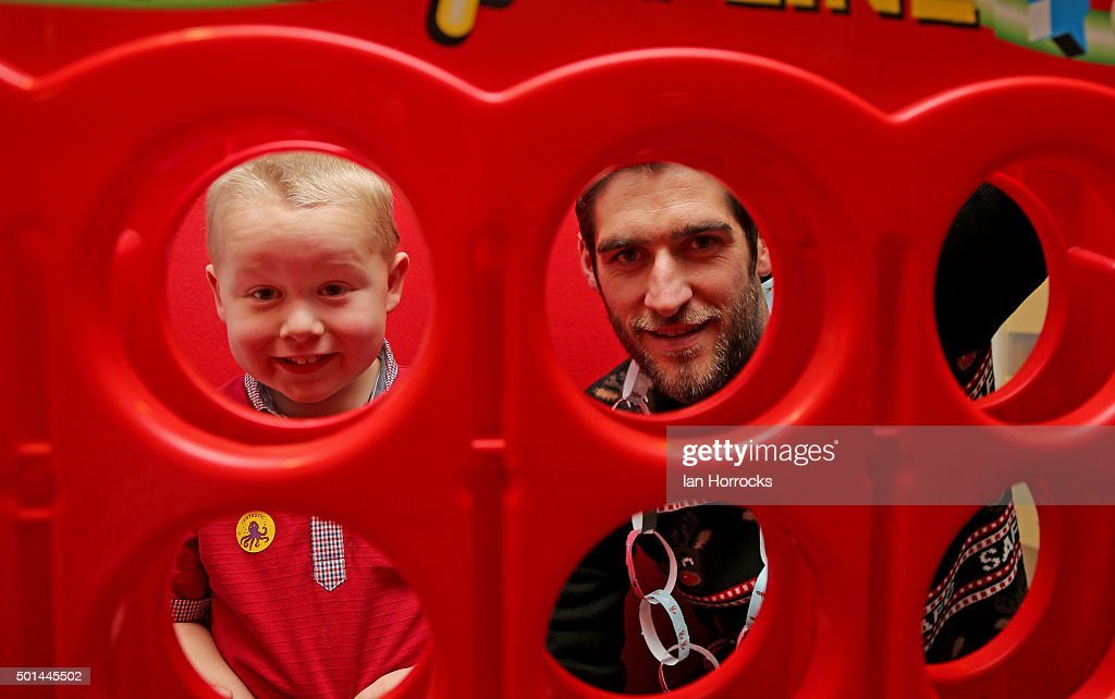Danny Graham plays connect four with Jack Wilson on the children wards at Durham University Hospital on December 15, 2015 in Sunderland, England.