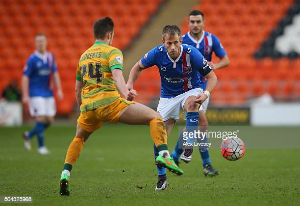 Danny Grainger of Carlisle United passes the ball past Connor Roberts of Yeovil Town during The Emirates FA Cup Third Round match between Carlisle...