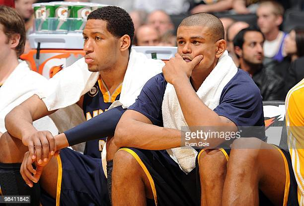 Danny Granger and Earl Watson of the Indiana Pacers look on from the bench during the game against the Los Angeles Lakers on March 2 2010 at Staples...