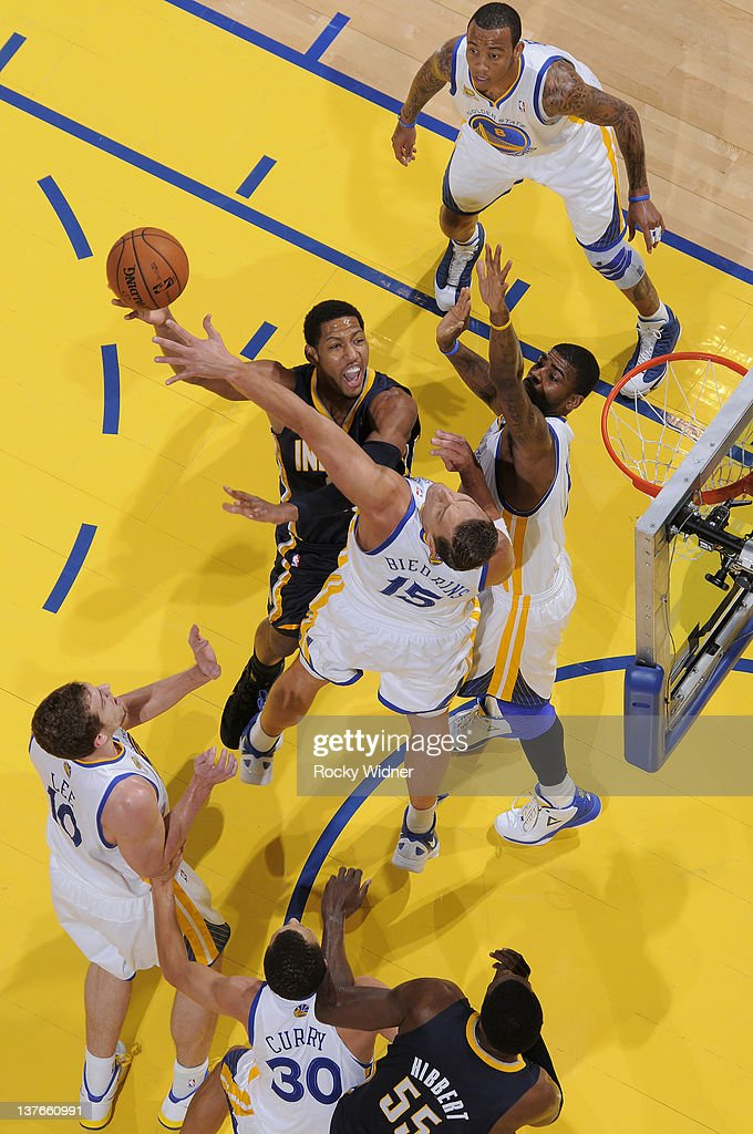<a gi-track='captionPersonalityLinkClicked' href=/galleries/search?phrase=Danny+Granger&family=editorial&specificpeople=553769 ng-click='$event.stopPropagation()'>Danny Granger</a> #33 of the Indiana Pacers attempts a hook shot over <a gi-track='captionPersonalityLinkClicked' href=/galleries/search?phrase=Andris+Biedrins&family=editorial&specificpeople=204473 ng-click='$event.stopPropagation()'>Andris Biedrins</a> #15 and <a gi-track='captionPersonalityLinkClicked' href=/galleries/search?phrase=Dorell+Wright&family=editorial&specificpeople=211344 ng-click='$event.stopPropagation()'>Dorell Wright</a> #1 of the Golden State Warriors on January 20, 2012 at Oracle Arena in Oakland, California.