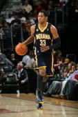 Danny Granger of the Indiana Pacers drives the ball against the Cleveland Cavaliers during the game at Quicken Loans Arena on April 9 2010 in...