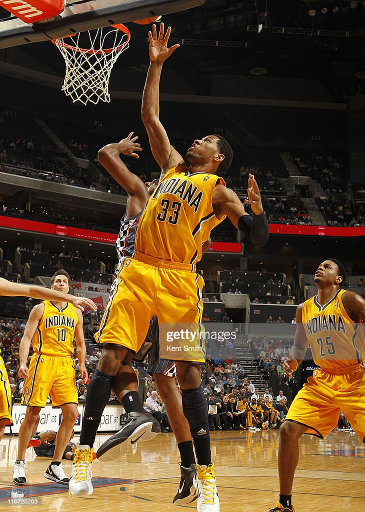 Danny Granger #33 of the Indiana Pacers grabs a rebound against the Charlotte Bobcats on March 23, 2011 at Time Warner Cable Arena in Charlotte, North Carolina.