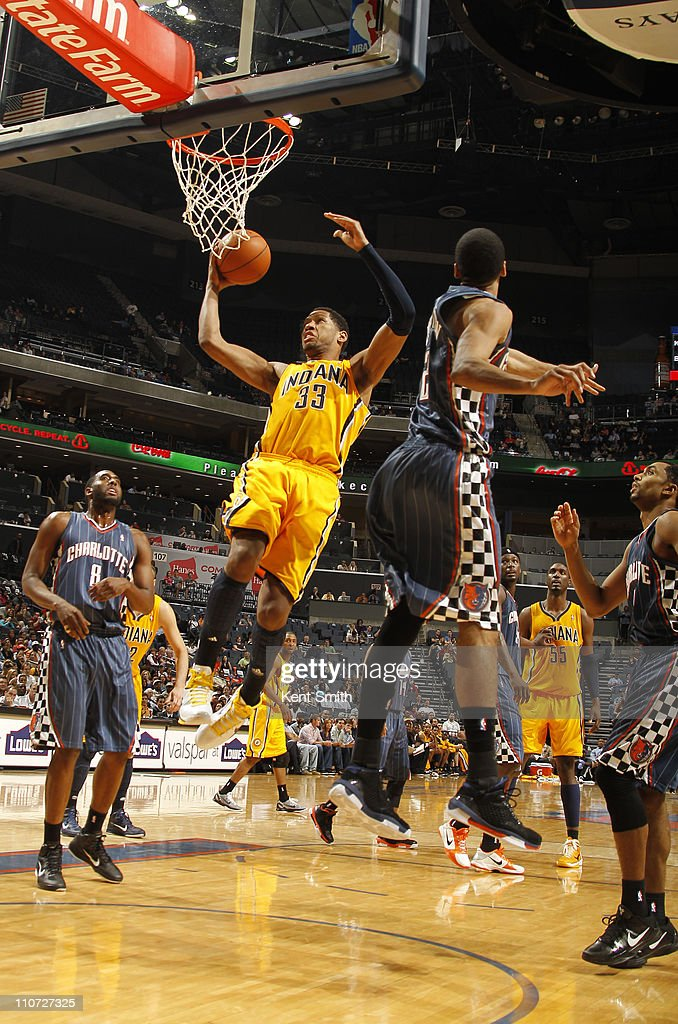 <a gi-track='captionPersonalityLinkClicked' href=/galleries/search?phrase=Danny+Granger&family=editorial&specificpeople=553769 ng-click='$event.stopPropagation()'>Danny Granger</a> #33 of the Indiana Pacers lays it in against the Charlotte Bobcats on March 23, 2011 at Time Warner Cable Arena in Charlotte, North Carolina.