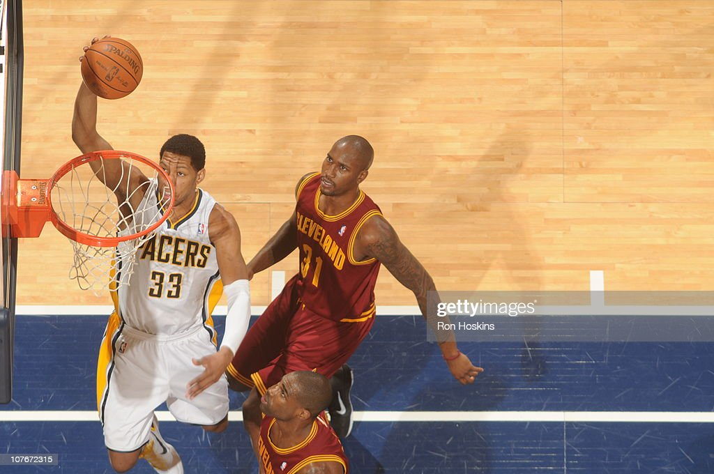 <a gi-track='captionPersonalityLinkClicked' href=/galleries/search?phrase=Danny+Granger&family=editorial&specificpeople=553769 ng-click='$event.stopPropagation()'>Danny Granger</a> #33 of the Indiana Pacers lays the ball up on <a gi-track='captionPersonalityLinkClicked' href=/galleries/search?phrase=Jawad+Williams&family=editorial&specificpeople=200696 ng-click='$event.stopPropagation()'>Jawad Williams</a> #31 of the Cleveland Cavaliers on December 17, 2010 at Conseco Fieldhouse in Indianapolis, Indiana.