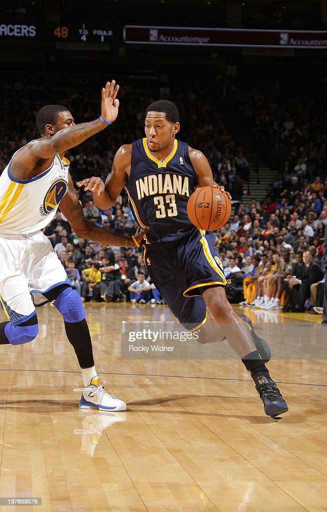 <a gi-track='captionPersonalityLinkClicked' href=/galleries/search?phrase=Danny+Granger&family=editorial&specificpeople=553769 ng-click='$event.stopPropagation()'>Danny Granger</a> #33 of the Indiana Pacers looks to push the ball against Dorell Wright #1 of the Golden State Warriors on January 20, 2012 at Oracle Arena in Oakland, California.