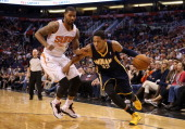Danny Granger of the Indiana Pacers moves the bal past Marcus Morris of the Phoenix Suns during the NBA game at US Airways Center on January 22 2014...