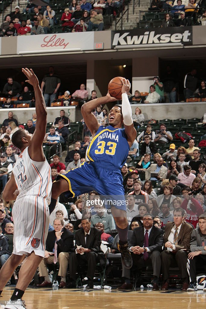 <a gi-track='captionPersonalityLinkClicked' href=/galleries/search?phrase=Danny+Granger&family=editorial&specificpeople=553769 ng-click='$event.stopPropagation()'>Danny Granger</a> #33 of the Indiana Pacers shoots against <a gi-track='captionPersonalityLinkClicked' href=/galleries/search?phrase=Boris+Diaw&family=editorial&specificpeople=201505 ng-click='$event.stopPropagation()'>Boris Diaw</a> #32 of the Charlotte Bobcats on February 19, 2012 at Bankers Life Fieldhouse in Indianapolis, Indiana.