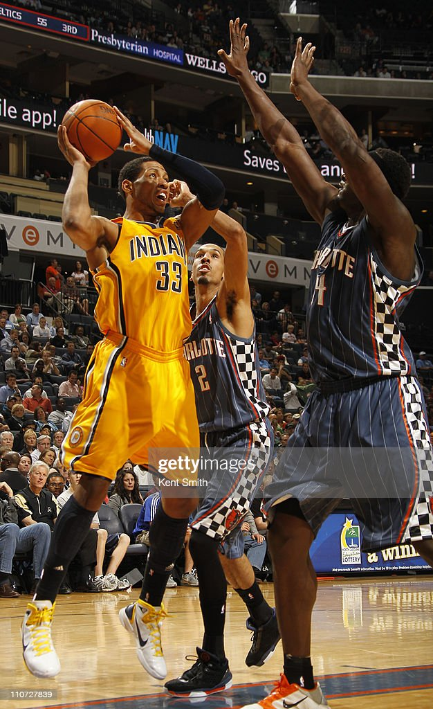 <a gi-track='captionPersonalityLinkClicked' href=/galleries/search?phrase=Danny+Granger&family=editorial&specificpeople=553769 ng-click='$event.stopPropagation()'>Danny Granger</a> #33 of the Indiana Pacers shoots against Shaun Livingston #2 of the Charlotte Bobcats on March 23, 2011 at Time Warner Cable Arena in Charlotte, North Carolina.