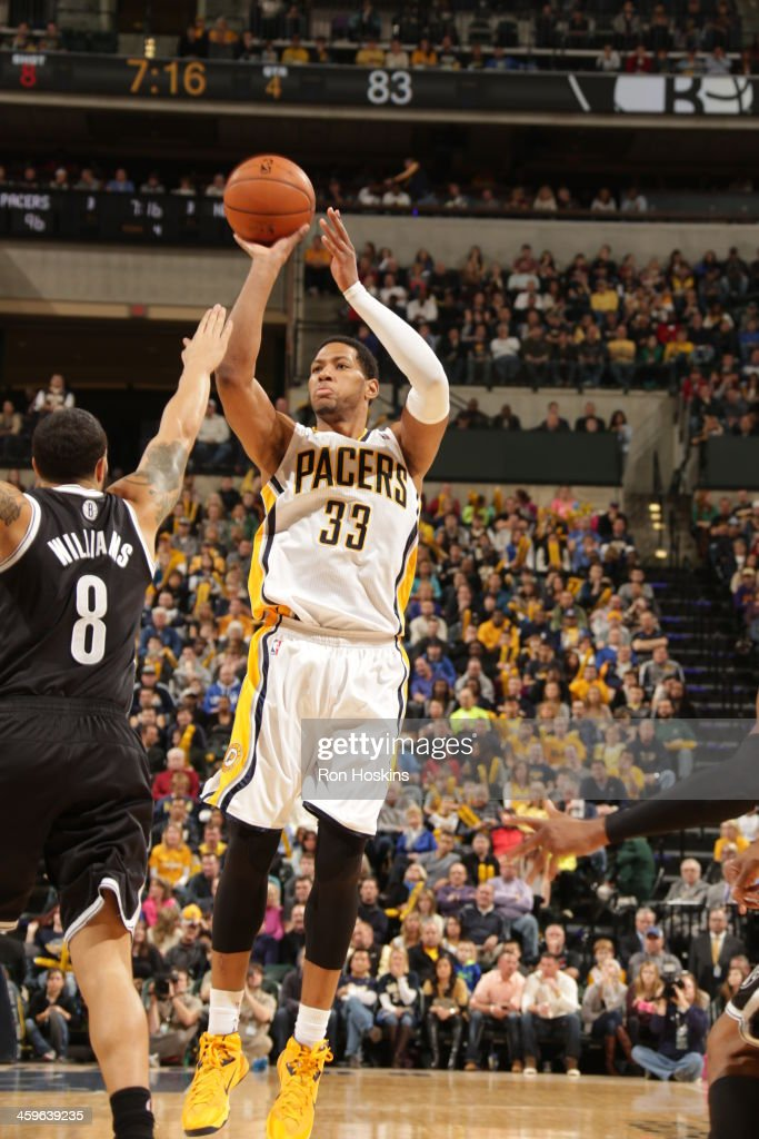 <a gi-track='captionPersonalityLinkClicked' href=/galleries/search?phrase=Danny+Granger&family=editorial&specificpeople=553769 ng-click='$event.stopPropagation()'>Danny Granger</a> #33 of the Indiana Pacers shoots the ball against the Brooklyn Nets at Bankers Life Fieldhouse on December 28, 2013 in Indianapolis, Indiana.