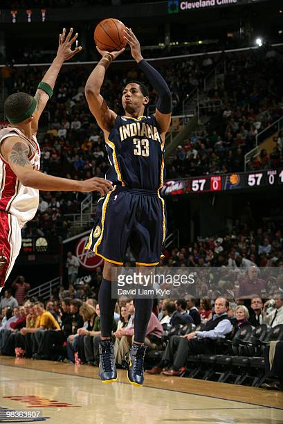 Danny Granger of the Indiana Pacers shoots the jumper over Jamario Moon of the Cleveland Cavaliers on April 9 2010 at The Quicken Loans Arena in...
