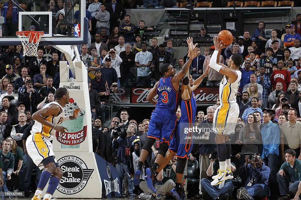 Danny Granger #33 of the Indiana Pacers takes the game-winning shot over Shawne Williams #3 and Jared Jeffries #9 of the New York Knicks on March 15, 2011 at Conseco Fieldhouse in Indianapolis, Indiana. The Pacers defeated the Knicks 119-117.