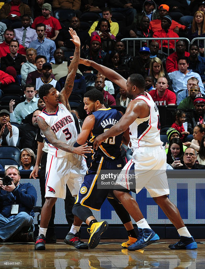 <a gi-track='captionPersonalityLinkClicked' href=/galleries/search?phrase=Danny+Granger&family=editorial&specificpeople=553769 ng-click='$event.stopPropagation()'>Danny Granger</a> #33 of the Indiana Pacers trapped between two defenders during a game against the Atlanta Hawks of the Atlanta Hawks against of the Indiana Pacers on January 8, 2014 at Philips Arena in Atlanta, Georgia.