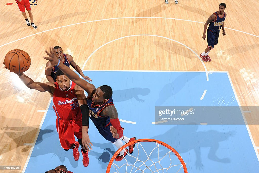 <a gi-track='captionPersonalityLinkClicked' href=/galleries/search?phrase=Danny+Granger&family=editorial&specificpeople=553769 ng-click='$event.stopPropagation()'>Danny Granger</a> #33 of the Los Angeles Clippers drives to the basket against the Denver Nuggets on March 17, 2014 at the Pepsi Center in Denver, Colorado.