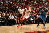 Danny Granger of the Miami Heat drives to the basket against Victor Oladipo of the Orlando Magic on December 29 2014 at American Airlines Arena in...