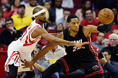 Danny Granger of the Miami Heat looks to pass the basketball as Corey Brewer of the Houston Rockets defends during their game at the Toyota Center on...