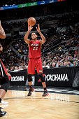Danny Granger of the Miami Heat passes the ball againsgt the San Antonio Spurs at the ATT Center on October 18 2014 in San Antonio Texas NOTE TO USER...