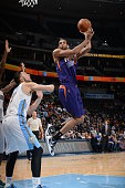 Danny Granger of the Phoenix Suns goes to the basket against the Denver Nuggets on February 25 2015 at the Pepsi Center in Denver Colorado NOTE TO...