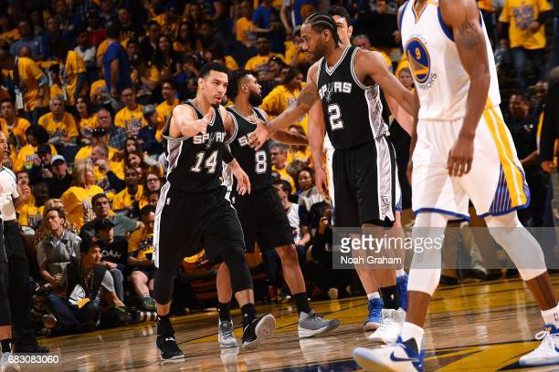 Danny Green and Kawhi Leonard of the San Antonio Spurs high five each other during the game against the Golden State Warriors during Game One of the...