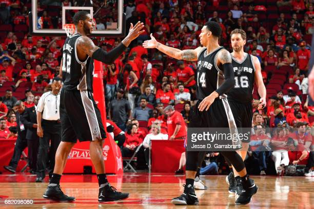Danny Green and LaMarcus Aldridge of the San Antonio Spurs high five each other during the game against the Houston Rockets during Game Six of the...