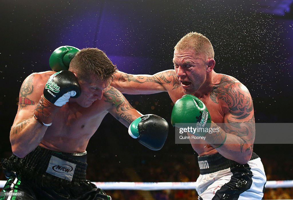 Danny Green of Australia and Shane Cameron of New Zealand exchange blows during their world title bout at Hisense Arena on November 21 2012 in...